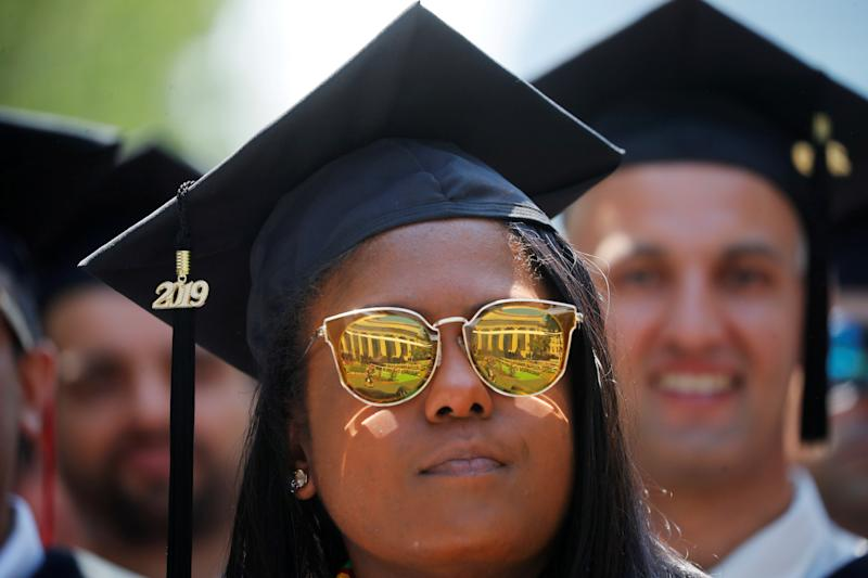 A graduating student listens as former New York City Mayor Michael Bloomberg delivers the Commencement Address during Commencement Exercises at the Massachusetts Institute of Technology (MIT) in Cambridge, Massachusetts, U.S., June 7, 2019. REUTERS/Brian Snyder TPX IMAGES OF THE DAY