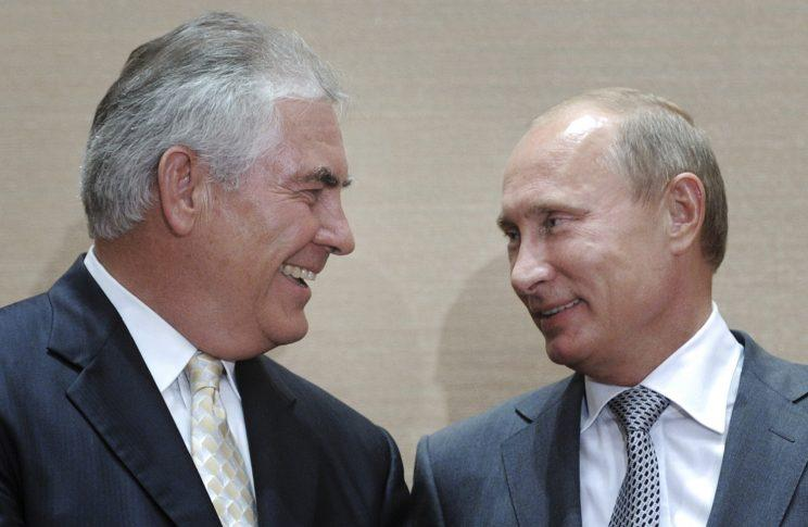 Russian Prime Minister Vladimir Putin, right, and Rex Tillerson, ExxonMobil's chief executive smile during a signing ceremony in the Black Sea resort of Sochi, Russia, Aug. 30, 2011. (Photo: Alexei Druzhinin/RIA Novosti via AP)