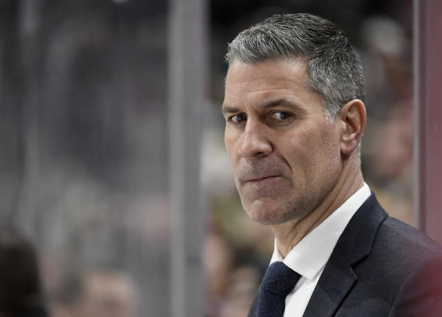 Colorado Avalanche head coach Jared Bednar watches his team play against the Minnesota Wild during the first period of an NHL hockey game Sunday, Feb. 9, 2020, in St. Paul, Minn. (AP Photo/Hannah Foslien)