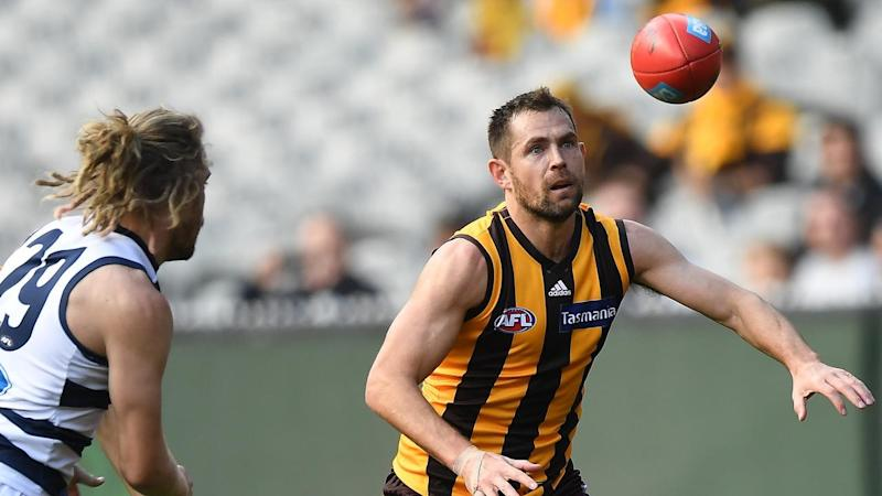 Luke Hodge (R) has played his 300th AFL game in Hawthorn's three-point loss to Geelong