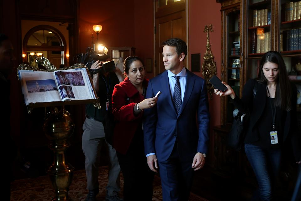 Congressman Aaron Schock speaks to the media as he arrives at an immigration reform panel hosted by the Illinois Business Immigration Coalition Monday, March 9, 2015, at St. Ignatius College Prep in Chicago. Schock resigned Tuesday amid controversy over his spending habits. (Nancy Stone/Chicago Tribune/Tribune News Service via Getty Images)