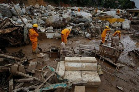 Rescuers look for bodies in a destroyed area, after flooding and mudslides caused by heavy rains leading several rivers to overflow, pushing sediment and rocks into buildings and roads, in Mocoa