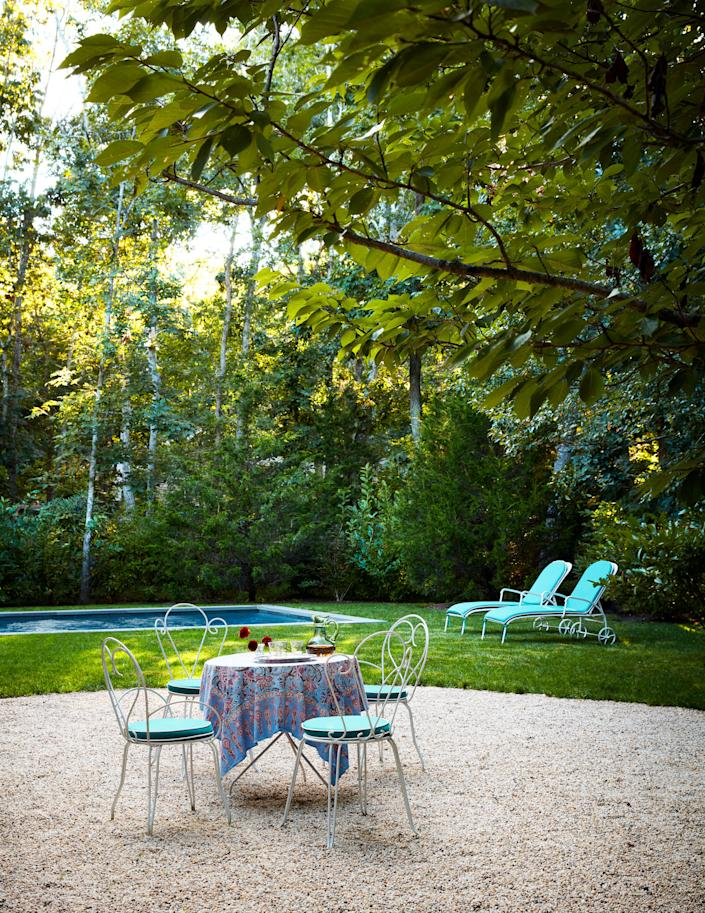 """<div class=""""caption""""> Landscape architect <a href=""""http://perryguillotinc.com/"""" rel=""""nofollow noopener"""" target=""""_blank"""" data-ylk=""""slk:Perry Guillot"""" class=""""link rapid-noclick-resp"""">Perry Guillot</a> designed the garden, which McGrath furnished with antique furniture cushioned in <a href=""""https://www.perennialsfabrics.com/"""" rel=""""nofollow noopener"""" target=""""_blank"""" data-ylk=""""slk:Perennials"""" class=""""link rapid-noclick-resp"""">Perennials</a> fabric. </div> <cite class=""""credit"""">Stephen Kent Johnson</cite>"""