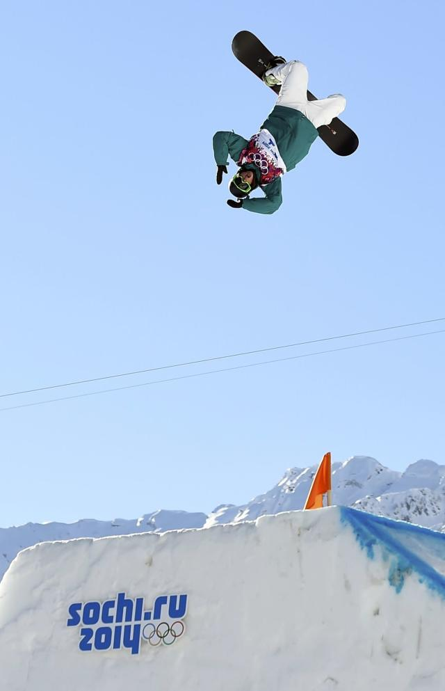 Australia's Scotty James performs a jump during the men's snowboard slopestyle semi-final competition at the 2014 Sochi Olympic Games in Rosa Khutor February 8, 2014. REUTERS/Dylan Martinez (RUSSIA - Tags: OLYMPICS SPORT SNOWBOARDING TPX IMAGES OF THE DAY)