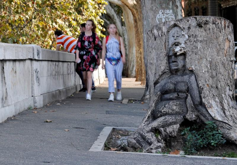 Andrea Gandini's sculputure from a dead tree stump is displayed in Rome