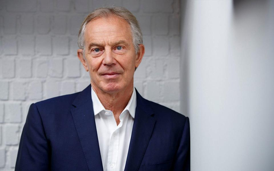 Tony Blair poses for a photograph ahead of an interview - TOLGA AKMEN/AFP