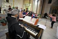 A choir prepares for celebrations of the upcoming Pope Francis' visit to Egypt, at Saint Joseph's Roman Catholic Church, in Cairo, Egypt April 23, 2017. REUTERS/Mohamed Abd El Ghany