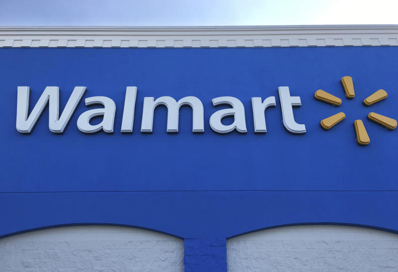 FILE - This Thursday, Jan. 5, 2017, file photo shows corporate signage at a Walmart in Kissimmee, Fla. Just over a year after Walmart spent more than $3 billion for the fast-growing online retailer Jet.com, it will launch a grocery line targeting millennials as it tries to contain Amazon.com. In August 2017, Amazon closed on its acquisition of Whole Foods, intensifying the competition between Walmart, Target, and supermarkets all fighting to win a bigger slice of the grocery market. (AP Photo/Swayne B. Hall, File)