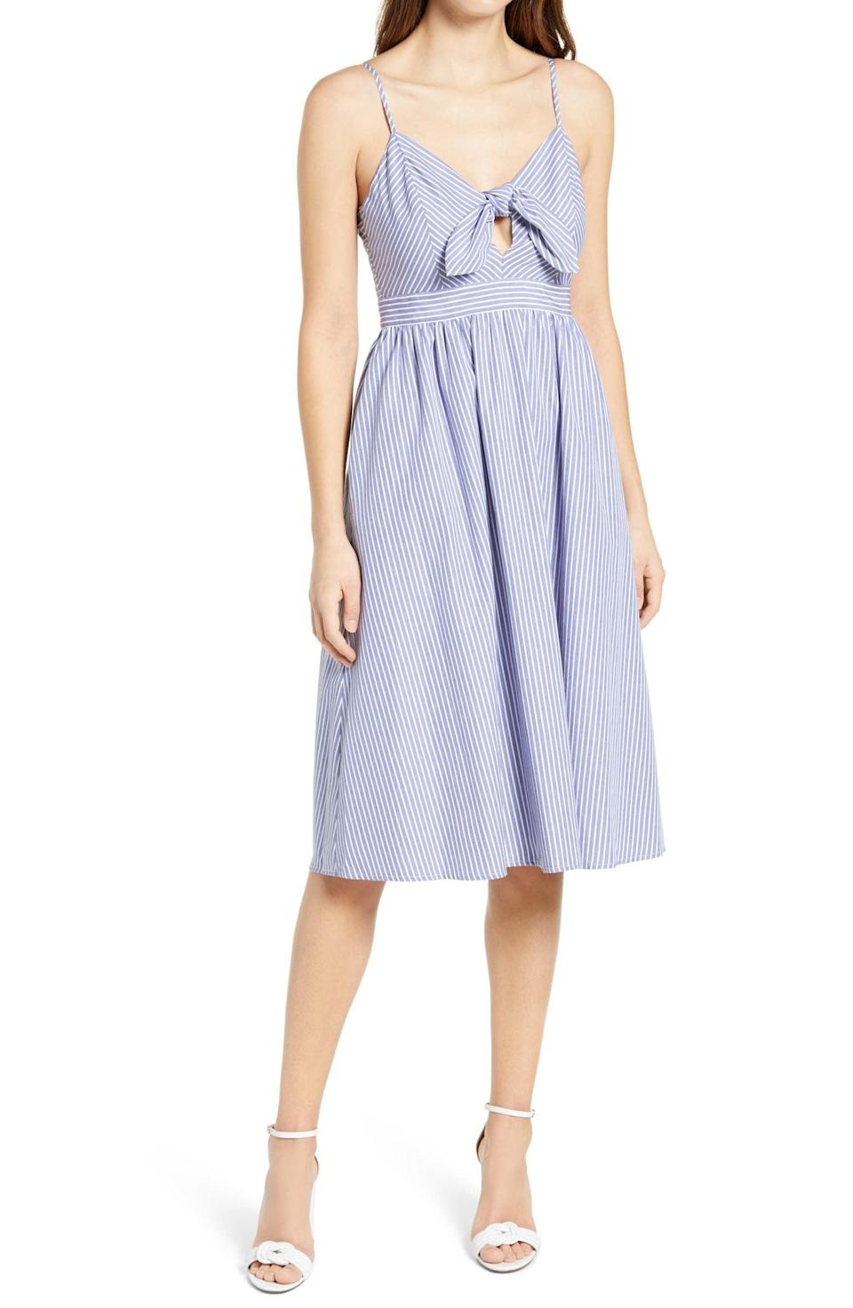 <p>You'll just want to go on park walks in this <span>Lulus Joyful Days Knot Front Sundress</span> ($57).</p>