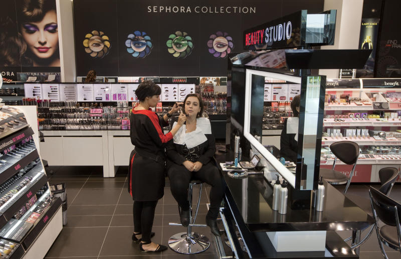 In this Jan. 23, 2013 photo, an employee applies make-up on a client at the Sephora store in Sao Paulo, Brazil. A flush new middle class and a population strong on working adults is dropping major cash on designer shampoos, lotions and cosmetics, rapidly turning this country into a beauty industry powerhouse. (AP Photo/Andre Penner)