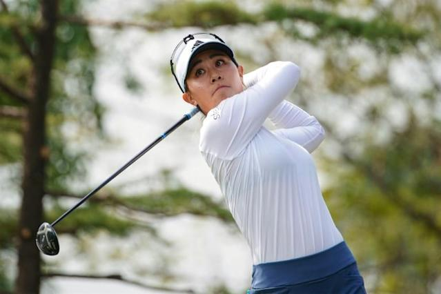 Danielle Kang capped her 27th birthday by winning the Buick LPGA Shanghai for a second time (AFP Photo/STR)