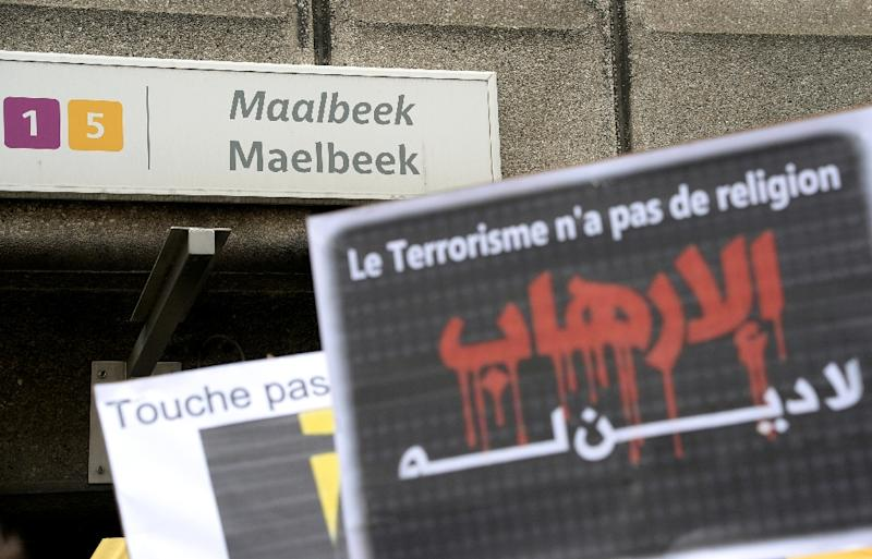A member of Belgium's Muslim Community holds a sign reading 'Terrorism has no religion' as people take part in a tribute to the victims of March 22 Brussels terror attacks, on April 9, 2016, outside of the Maelbeek/Maalbeek metro station (AFP Photo/Thierry Charlier)
