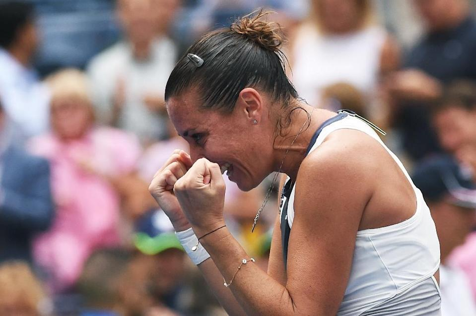 Flavia Pennetta celebrates after defeating Simona Halep during their 2015 US Open Women's singles semifinal match in New York on September 11, 2015 (AFP Photo/Jewel Samad)
