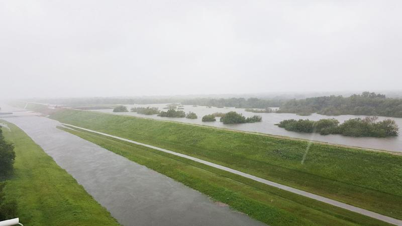 (Photo: Police block a flooded road near the Barker and Addicks reservoirs in Houston)