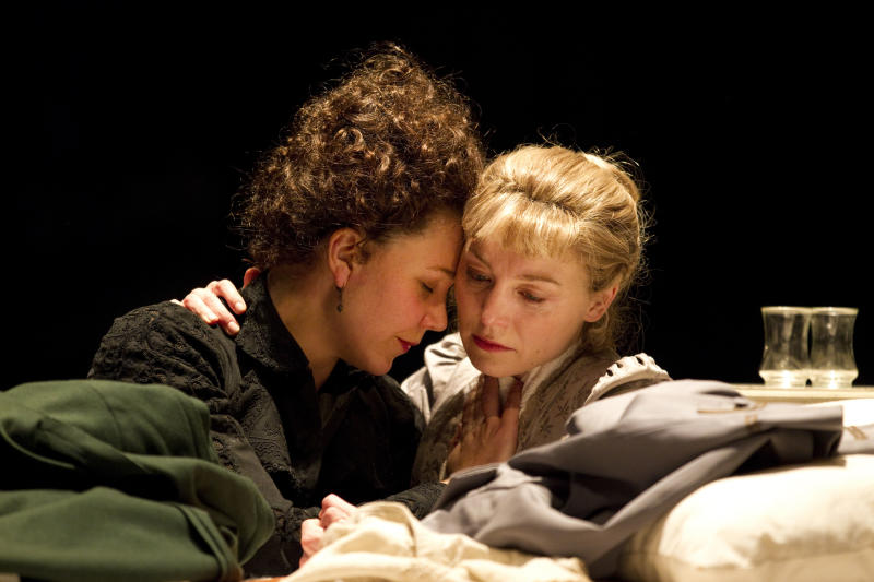 """In this theater publicity image released by The Publicity Office, Maggie Gyllenhaal, left, and Juliet Rylance, are shown in a scene from Anton Chekhov's """"Three Sisters,"""" performing off-Broadway at Classic Stage Company in New York.  (AP Photo/The Publicity Office, Joan Marcus)"""