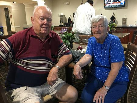 JW and Helen Neal sit in a hotel one mile from their beachfront house in Panama City