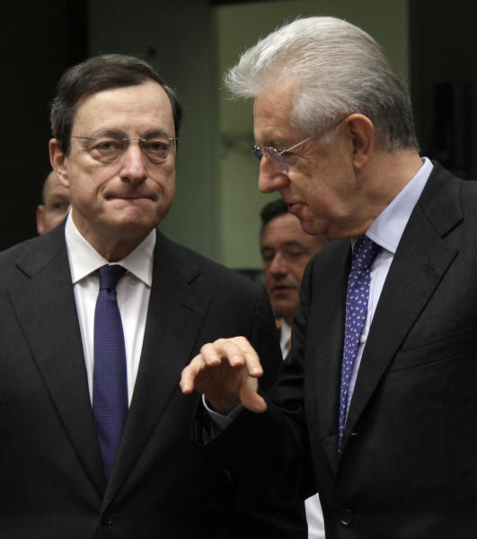 Italian Prime Minister Mario Monti, right, speaks with European Central Bank President Mario Draghi during a meeting of eurozone finance ministers at the EU Council building in Brussels on Monday, March 12, 2012. The 17 euro countries are trying to focus on issues beyond the Greek crisis and deal with longer-term issues in their currency union. Finance ministers, meeting in Brussels on Monday, will discuss Spain's high deficits and potentially dangerous imbalances in other countries. (AP Photo/Virginia Mayo)