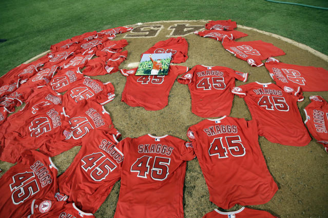 Jerseys with pitcher Tyler Skaggs' number are placed on the mound after the Los Angeles Angels completed a combined no-hitter against the Seattle Mariners during a baseball game Friday, July 12, 2019, in Anaheim, Calif. (AP Photo/Marcio Jose Sanchez)