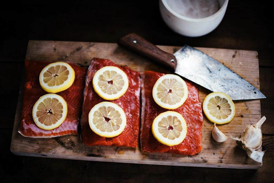 """<p>For the cook who loves to throw some salmon on the grill, Salmon Sisters ships sustainably-sourced Alaskan salmon straight to their door. Limited in availability, each box of coho salmon comes with a copy of their <a href=""""https://www.marthastewart.com/7793939/salmon-sisters-cookbook-alaska"""" rel=""""nofollow noopener"""" target=""""_blank"""" data-ylk=""""slk:cookbook"""" class=""""link rapid-noclick-resp"""">cookbook</a>. Coho salmon is a Pacific species known for its mild flavor and firm texture, which stands up well to grilling.</p> <p><strong><em>Shop Now:</em></strong><em> Salmon Sisters Wild Alaska Coho Salmon Box, $209, </em><a href=""""https://aksalmonsisters.com/collections/frozen-seafood/products/wild-alaska-coho-salmon-box"""" rel=""""nofollow noopener"""" target=""""_blank"""" data-ylk=""""slk:aksalmonsisters.com"""" class=""""link rapid-noclick-resp""""><em>aksalmonsisters.com</em></a>.</p>"""