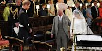 <p>Walking Meghan Markle down the aisle at St. George's Chapel during her wedding to his son, Prince Harry. </p>