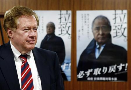 Robert King, U.S. special envoy for North Korean human rights issues, stands in front of campaign posters of Japan's abduction issue during a meeting with Japan's Minister-in-Charge of the Abduction Issue and head of the national public safety commission Keiji Furuya (not in picture) in Tokyo August 28, 2013.