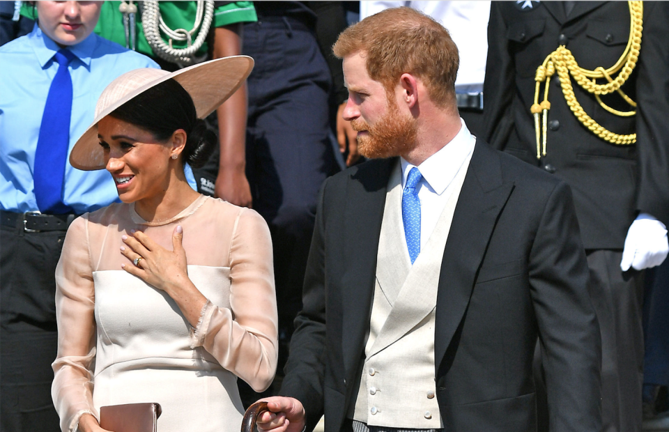 The Duke and Duchess of Sussex step out for their first royal engagement – a garden party for Prince Charles' birthday. [Photo: Getty]