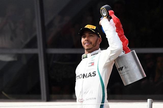 Hamilton holds his trophy after the 65th win of his career having dominated the entire weekend (AFP Photo/Boris HORVAT )