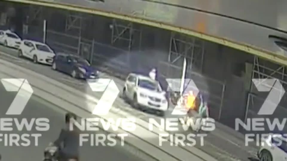 The white 4WD can be seen pulling onto the street. Source: 7 News