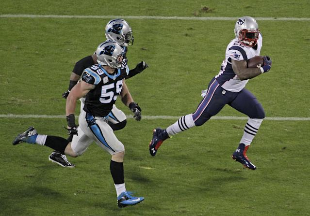 New England Patriots' Stevan Ridley (22) runs as Carolina Panthers' Luke Kuechly (59) pursues during the first half of an NFL football game in Charlotte, N.C., Monday, Nov. 18, 2013. (AP Photo/Bob Leverone)