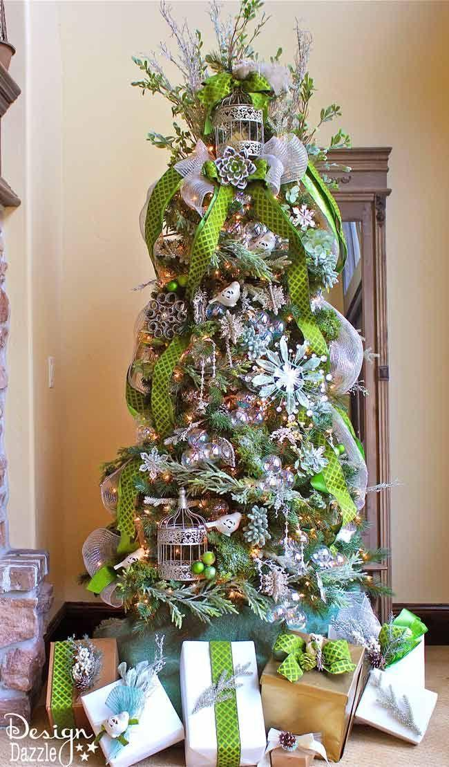"""<p>Iridescent ornaments, silver-glittered accents, and tons of green touches turn a tree into a jeweled forest masterpiece. </p><p><strong><em>Get the tutorial at <a href=""""https://www.designdazzle.com/michaels-dream-tree-challenge-2013/?crlt.pid=camp.fgzkAxWpX0o0"""" rel=""""nofollow noopener"""" target=""""_blank"""" data-ylk=""""slk:Design Dazzle"""" class=""""link rapid-noclick-resp"""">Design Dazzle</a>. </em></strong></p><p><a class=""""link rapid-noclick-resp"""" href=""""https://www.amazon.com/Nuptio-Centerpieces-Decorative-Lanterns-Birdcage/dp/B07TLNDGNT?tag=syn-yahoo-20&ascsubtag=%5Bartid%7C10070.g.2025%5Bsrc%7Cyahoo-us"""" rel=""""nofollow noopener"""" target=""""_blank"""" data-ylk=""""slk:SHOP BIRD CAGES"""">SHOP BIRD CAGES</a></p>"""