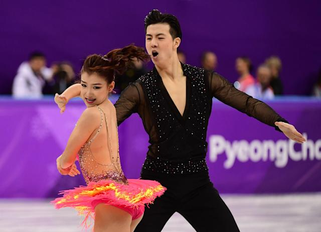 <p>China's Wang Shiyue and Liu Xinyu compete in the ice dance short dance of the figure skating event during the Pyeongchang 2018 Winter Olympic Games at the Gangneung Ice Arena in Gangneung on February 19, 2018. / AFP PHOTO / Roberto SCHMIDT </p>