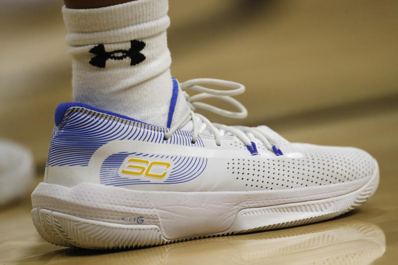 Under Armour shoe and sock worn by UCLA player in the first half of an NCAA college basketball game Sunday, Jan. 12, 2020, in Boulder, Colo. (AP Photo/David Zalubowski)