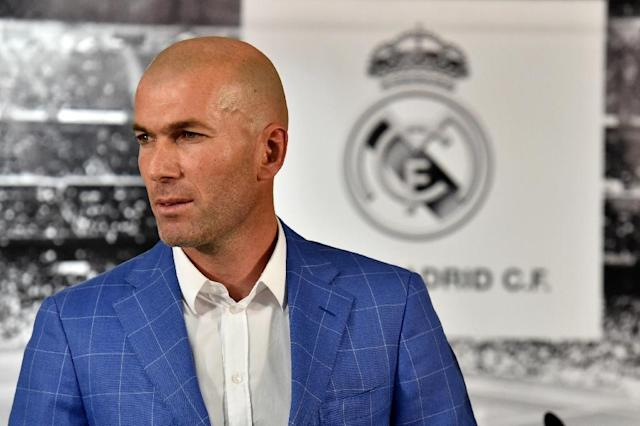 Real Madrid's new French coach Zinedine Zidane poses after a statement made by the club's president, at Santiago Bernabeu stadium in Madrid, on January 4, 2016 (AFP Photo/Gerard Julien)