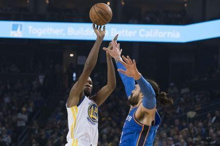 October 16, 2018; Oakland, CA, USA; Golden State Warriors forward Kevin Durant (35) shoots the basketball against Oklahoma City Thunder center Steven Adams (12) during the first quarter at Oracle Arena. Mandatory Credit: Kyle Terada-USA TODAY Sports