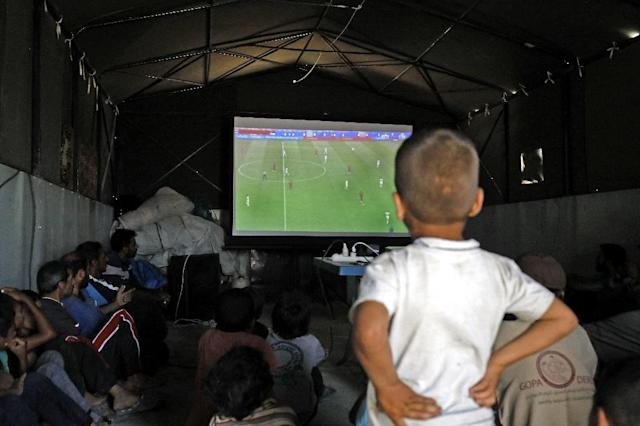 World Cup matches are screened inside tents during the day and outside in the evening (AFP Photo/Delil SOULEIMAN)