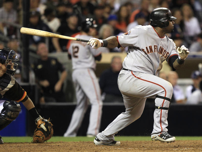San Francisco Giants' Pablo Sandoval lines a base hit to left with the bases loaded that brings in two runs against the San Diego Padres during the Giants' five run  rally in the 12th inning of a baseball game Thursday, July 14, 2011 in San Diego. (AP Photo/Lenny Ignelzi)