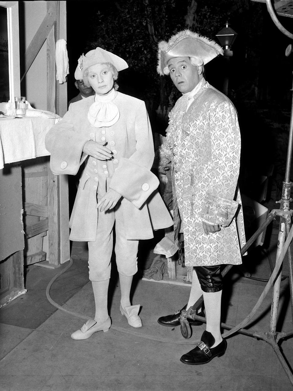 <p>Lucille and Desi pose in costume for the final episode of <em>I Love Lucy</em>. The show ended for a myriad of reasons, including the busy schedule of the stars, who were running Desilu Productions at the same time as writing their show.</p>