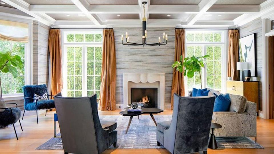 One of the room's in the home with a wood-burning fireplace. - Credit: Realtor.com