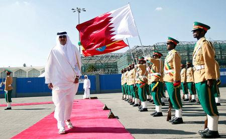 FILE PHOTO: Qatari Emir Sheikh Tamim bin Hamad al-Thani inspects a guard of honor upon arriving at the Bole International Airport during his official visit to Ethiopia's capital Addis Ababa