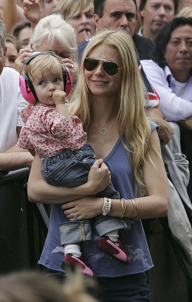 Gwyneth Paltrow holds daughter Apple during Coldplay's performance at