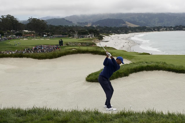 Tiger Woods hits out of the bunker on the ninth hole during the second round of the U.S. Open Championship golf tournament Friday, June 14, 2019, in Pebble Beach, Calif. (AP Photo/David J. Phillip)