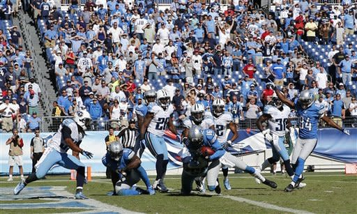 Detroit Lions wide receiver Titus Young (16) scores a touchdown after he caught a pass that was tipped in the end zone on a 46-yard pass play against the Tennessee Titans in the final moments in the fourth quarter of an NFL football game on Sunday, Sept. 23, 2012, in Nashville, Tenn. (AP Photo/Joe Howell)