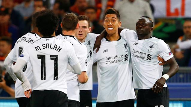 <p>Liverpool players celebrate the opening goal</p>