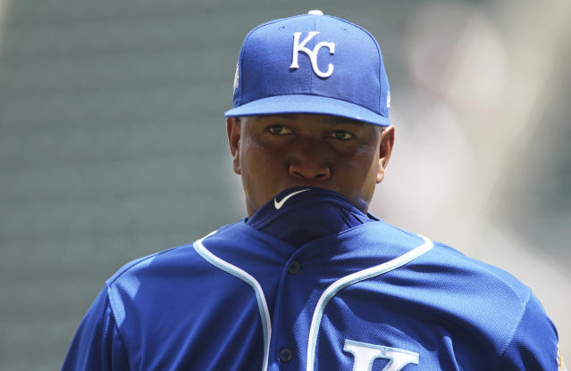 Kansas City Royals reliever Enny Romero bites his jersey on the way to the dugout after the sixth inning of a baseball game against the Minnesota Twins, Wednesday, July 11, 2018, in Minneapolis. (AP Photo/Jim Mone)