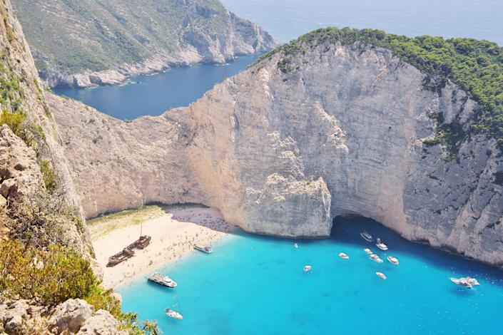 <p>Huge limestone cliffs skyrocket above gorgeous turquoise waters. Whether you come for a day trip or for a few nights while Greek island hopping, make sure you squeeze in an excursion to the notorious shipwreck beach at Smuggler's Cove. </p>
