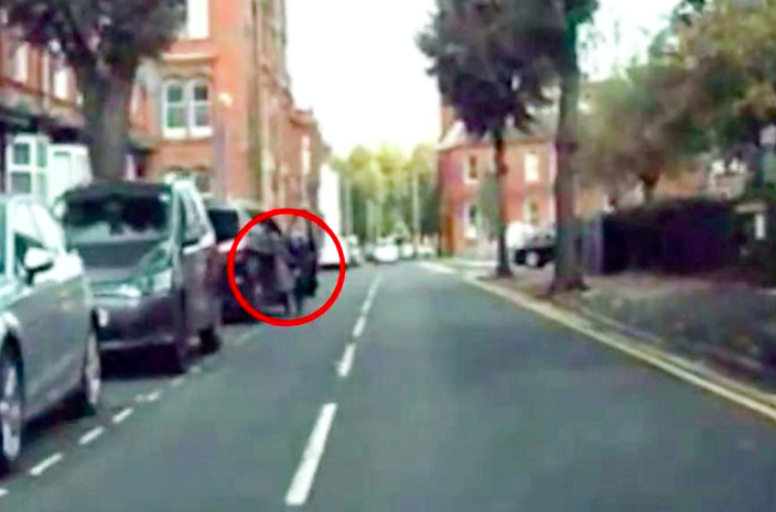 The woman was half inside the car when it was stolen. (SWNS)