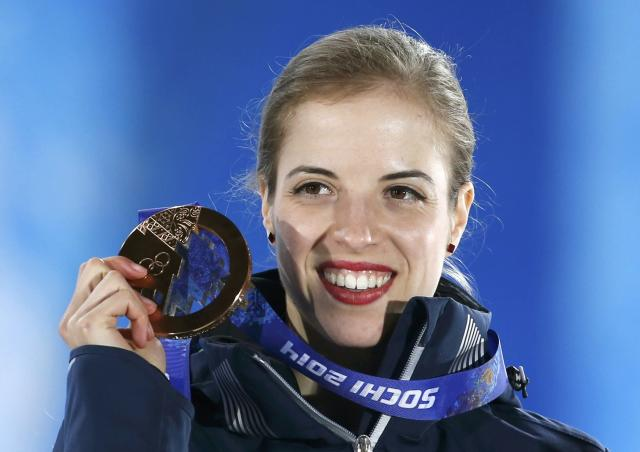 Bronze medallist Italy's Carolina Kostner poses during the victory ceremony for the figure skating women's free skating program at the 2014 Sochi Winter Olympics February 21, 2014. REUTERS/Issei Kato (RUSSIA - Tags: OLYMPICS SPORT FIGURE SKATING)
