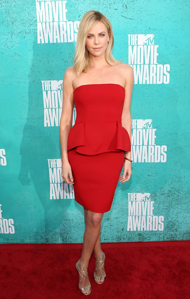 Charlize Theron arrives at the 2012 MTV Movie Awards.