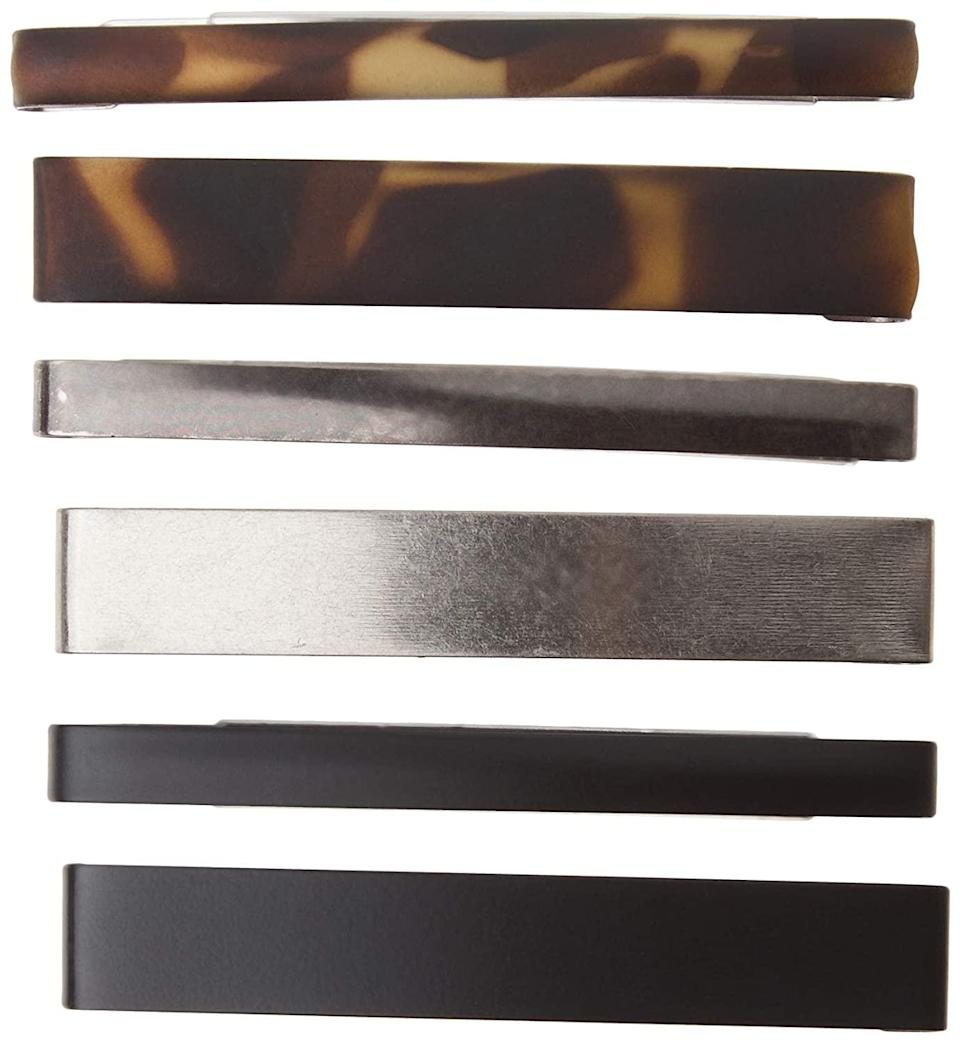 """<p>When you have a pack of mix-and-match clips like these Scünci No-Slip Grip Stay Tight Barrettes, don't hold back on styling them all at once. """"Wear them below your topknot on the back of your head or on the side over your ear,"""" says Rubenstein. She also suggests throwing one onto a bun, just to give it a little extra flair. We like that these have a slight grip on the inside, so they won't slide out. </p> <p><strong>$4 for six</strong> (<a href=""""https://www.amazon.com/Scunci-No-slip-Tight-Barrettes-Colors/dp/B001T8OF62?ref_=ast_sto_dp"""" rel=""""nofollow noopener"""" target=""""_blank"""" data-ylk=""""slk:Shop Now"""" class=""""link rapid-noclick-resp"""">Shop Now</a>)</p>"""