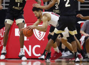 North Carolina State's Devon Daniels (24) escapes the pressure from Wake Forest defenders during the first half of an NCAA college basketball game Wednesday, Jan. 27, 2021, in Raleigh, N.C. (Ethan Hyman/The News & Observer via AP, Pool)
